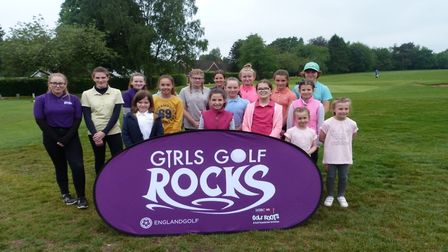 A photo of the 'Girls Golf Rocks on Tour' participants and ambassadors, taken during the event at De