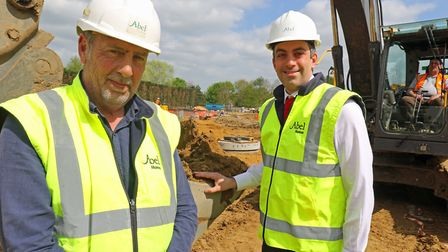 Abel Homes site manager Alan Read (left) and managing director Paul LeGrice cut the first sod at the