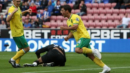 Wes Hoolahan celebrates his goal at Wigan on the opening day of the 2011-12 season Picture: Paul Che