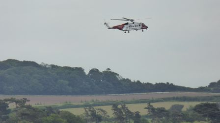 A helicopter at Titchwell marsh, where a 75-year-old man was rescued after being missing for 24 hour