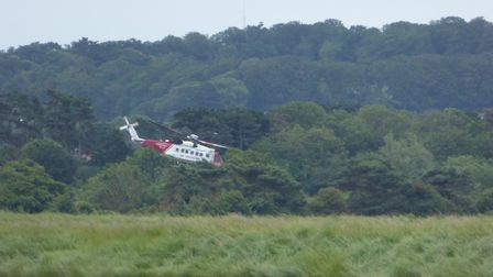A helicopter at Titchwell marsh, where a 75-year-old man was rescued having been missing for 24 hour