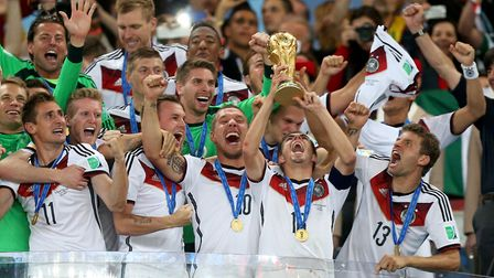 Germany's Philipp Lahm lifts the World Cup trophy in 2014. Photo: PA / Mike Egerton