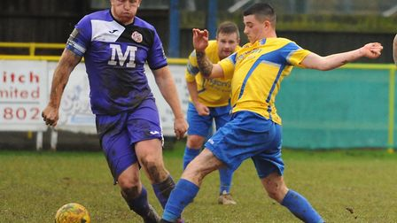 Henry Pollock, right, in action for Norwich United last season. Picture: DENISE BRADLEY