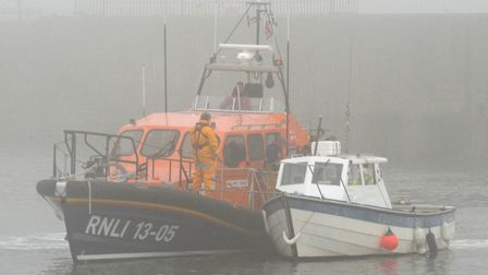 Lowestoft's lifeboat was called to help the crew of a fishing boat that broke down in thick fog off