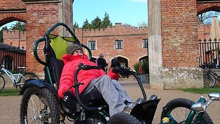 Martin Symons is cycling from Norwich to King's Lynn in an adapted four-wheeled bicycle called a Bom