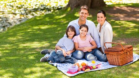 A family enjoying a picnic. Picture: GETTY IMAGES/WAVEBREAK MEDIA