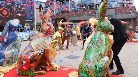Confetti flies at the big reveal of the GoGoHares at a Hare PremiHare at Riverside, with patron Jake