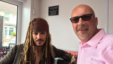 Captain Jack Sparrow helps out with the opening of One Stop in Cromer. Picture with owner Andy Mills