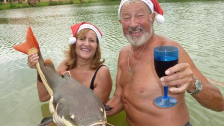 Catch of Christmas Day! Jo and John Wilson celebrating Christmas in Thailand in their own lake. Pic: