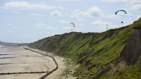 Paragliders at Mundesley beach and cliffs in the summer sunshine. Picture: MARK BULLIMORE