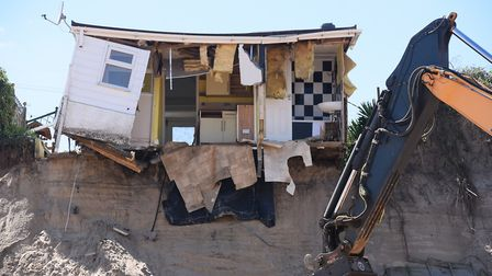 A house teeters on the cliff edge at Hemsby Picture: DENISE BRADLEY