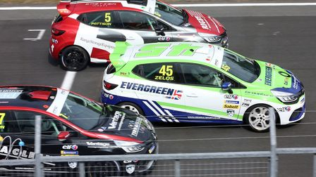 Dereham's Dan Zelos (45) in the thick of the action in race two of the Renault UK Clio Cup at Oulton