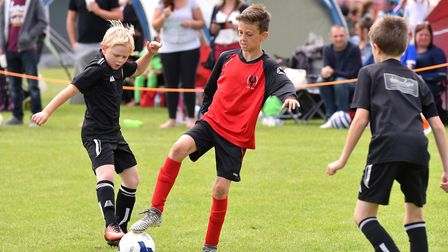 Action from the Costessey Sports Club 5-A-Side Tournament.Needham Phoenix (red and black) V Sprowst