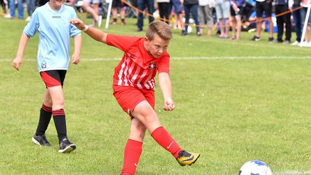 Action from the Costessey Sports Club 5-A-Side Tournament.Fireside Flames (Red) V Costessey Harriers