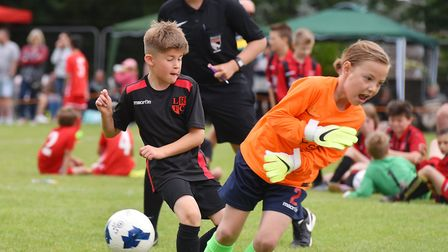 Action from the Costessey Sports Club 5-A-Side Tournament. Costessey Eagles (green) V Lakeford under