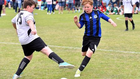 Action from the Costessey Sports Club 5-A-Side Tournament. Taverham (Blue and black) V Drayton Under