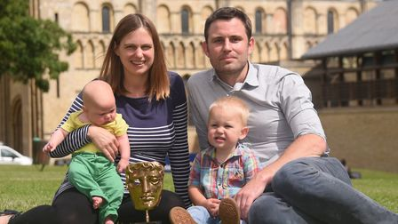 Filmmaker, Rob Whitworth, with his BAFTA, and his family, wife Sue, and sons Freddy and Charlie, at