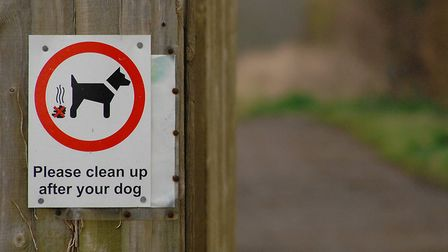 A sign asking dog owners to clean up after their pets. Picture: Chris Bishop