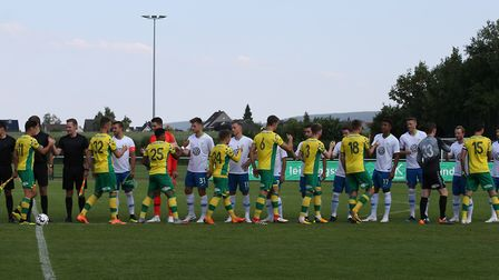 The Norwich and Wolfsburg players shake hands before the friendly match at August Wenzel Stadium in