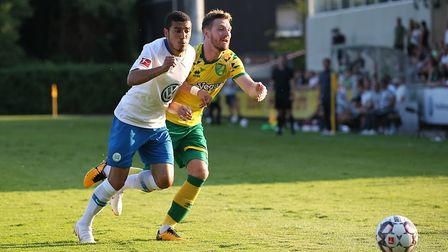 William of VfL Wolfsburg and James Husband of Norwich in action during the Friendly match at August