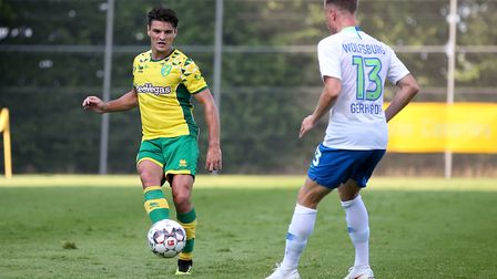 Ben Marshall of Norwich and Yannick Gerhardt of VfL Wolfsburg in action during the Friendly match at
