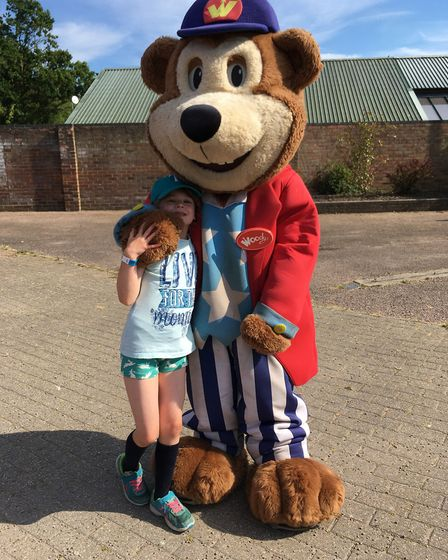 A day at Pleasurewood Hills is not complete without a cuddle with Woody. Picture: contributed