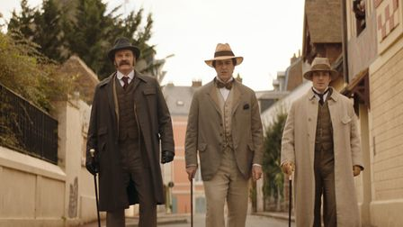 Colin Firth as Reggie Turner, Rupert Everett as Oscar Wilde and Edwin Thomas as Robbie Ross in The H