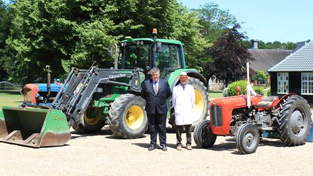 Tractor day at Gresham's School in Holt. Pictured are headmaster Douglas Robb and long-serving Gresh