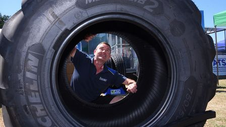 Ian Keates from Michelin, sets up a tyre at the ATS stand ready for the Royal Norfolk Show. Picture: