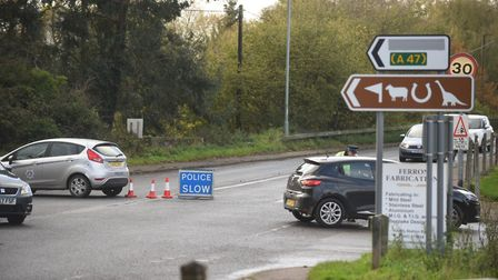 Police on the A1067 after a four-vehicle crash between Great Witchingham and Sparham. Pictured is t