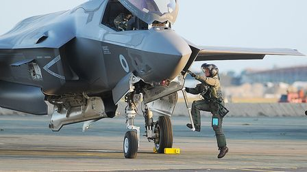 Wing Commander John Butcher is greeted on his arrival at RAF Marham as the F-35 touches down on Norf