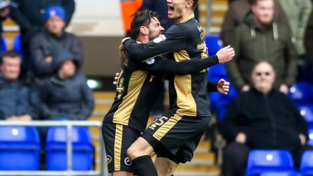 Ben Marshall is smothered by Jake Cooper after Millwall score at Ipswich last season. Picture: STEVE