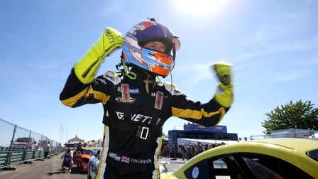 Fin Green celebrating his first every Ginetta Junior race victory for the Norfolk-based Elite Motors