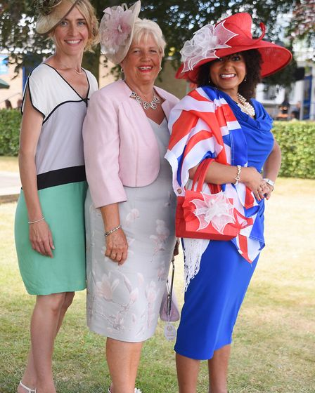Headline hat competition winner, Bekah Boone, left, and best dressed winners, Chris Taylor, centre,