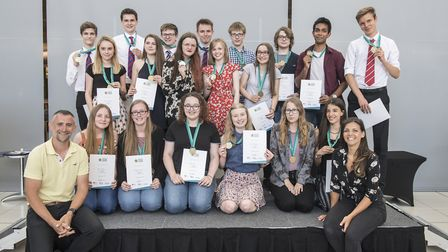 Some of the students who won awards at the Youth STEMM Awards, pictured with astronomer Mark Thompso