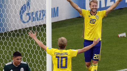 Sweden's one-time Norwich City target Ola Toivonen and Emil Forsberg (10) celebrate a goal during th