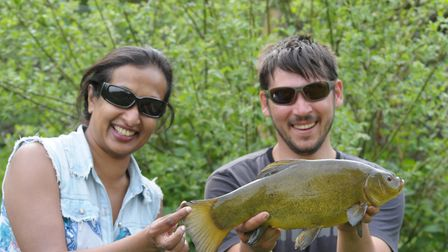 Great mate Robbie Northman and my partner Enoka celebrate a tench Picture: John Bailey