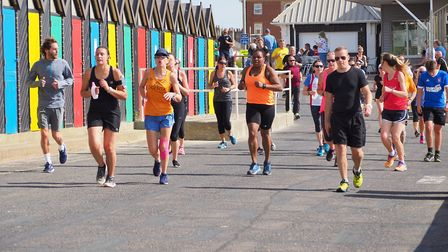 Parkrunners cruise down the promenade at Lowestoft on Saturday. Picture: Gary Pembroke