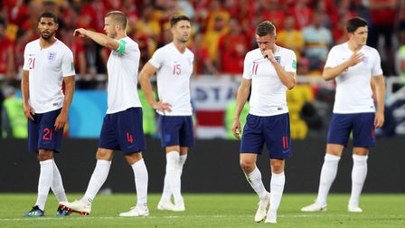 England on their way to defeat by Belgium Picture: PA