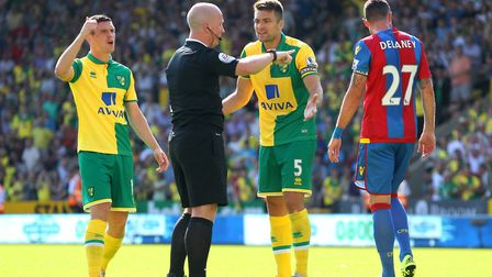 Russell Martin argues with eeferee Simon Hooper after a goal by Cameron Jerome is disallowed Pictur