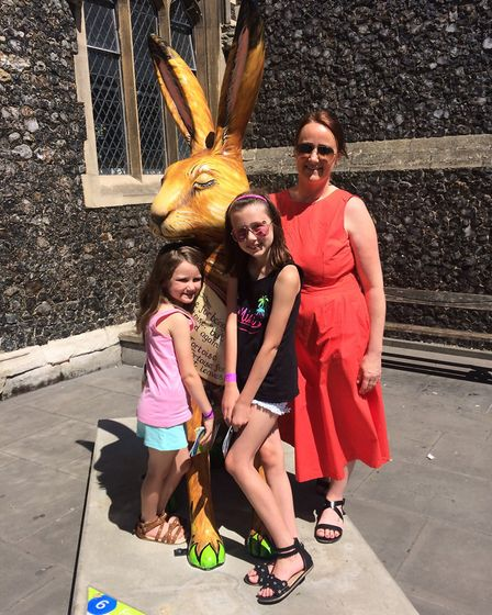 Kelly Brown and her daughters Mollie and Lily with Foxy's Tale the GoGoHare.Photo: Emma Knights