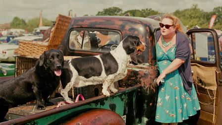 Woman at car boot sale with dogs, St Germans Picture: Si Barber