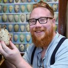 Dr David Waterhouse with one of the two Great Auk eggs at the Norwich Castle Museum. Picture: DENISE