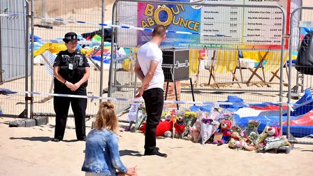 Floral tributes and soft toys have been left at the scene on Gorleston beach where a young girl died