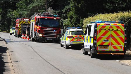 Emergency services at Brow of the Hill, after a large area of scrub caught light Picture: Chris Bis