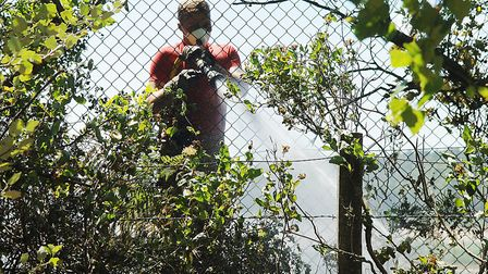 A firefighter at the large scrub fire at Brow of the Hill, Leziate Picture: Chris Bishop