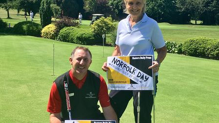 Neil Lythgoe, director of golf at the Royal Norwich Golf Club, and club member Jan Redment. The club