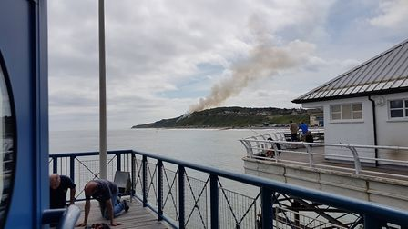 Smoke rising from the scene of the fire near Cromer Lighthouse. Picture: DAVE TAPPER