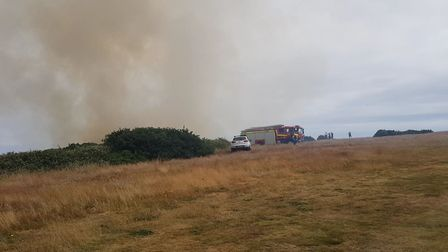 Smoke rising from the scene of the fire near Cromer Lighthouse. Picture: RICK GARTH