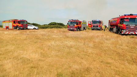 Fire crews were called to the scene of the blaze near Cromer Lighthouse. Picture: DAVID 'HUBBA' ROBE